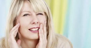 đau khớp cắn khi bọc răng sứ